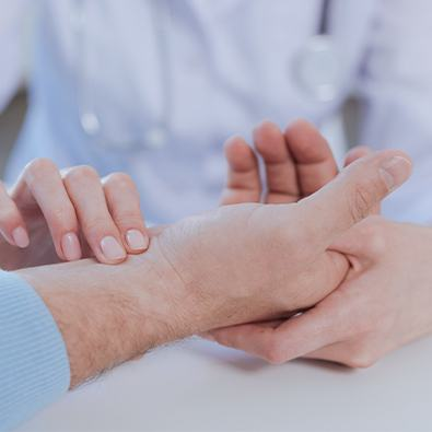 Doctor examining hand of patient with arthritis