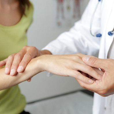 doctor holding woman's wrist who may have carpal tunnel syndrome