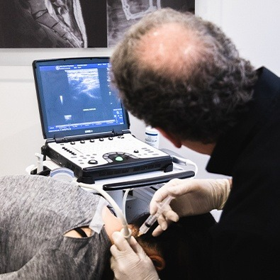Dr. Tortland using diagnostic injections and ultrasound system