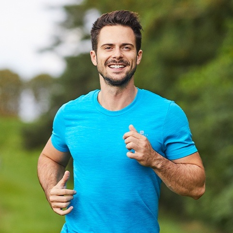 Man jogging after treatment for hip injury
