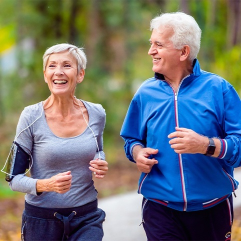 Man and woman jogging after woman received treatment for labral tears