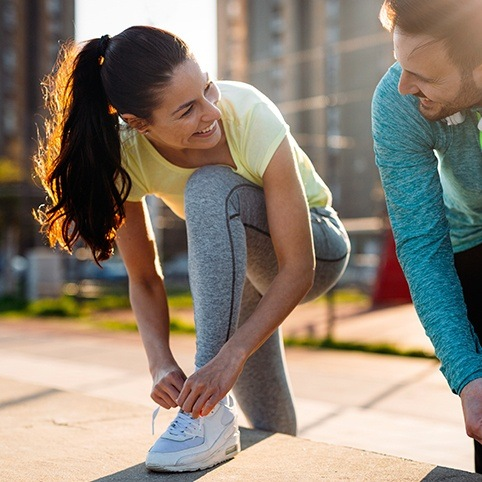 Woman and man going for a run after treatment for meniscal tear