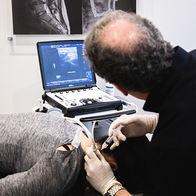 Dr. Tortland performing prolotherapy