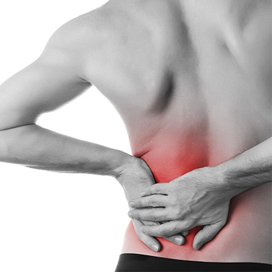 Man with low back pain holding hip