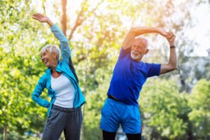 older couple stretching outdoors