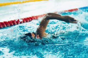 man swimming in Olympic pool
